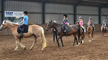 Aanbieding 1: Paardrijles in groepsverband voor mensen met een beperking (18 lessen)